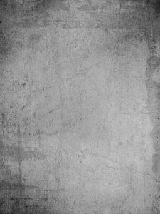 Hintergrundbild bestehend aus schwarz-grau-Tönen, die im Grunge-Look in unkoordinierten Kleksen bzw. Flecken angeordntet sind